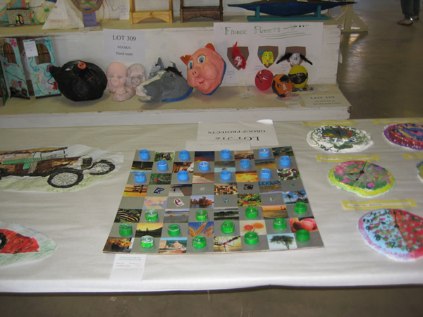 Group project of a hand made checker board and pieces.
