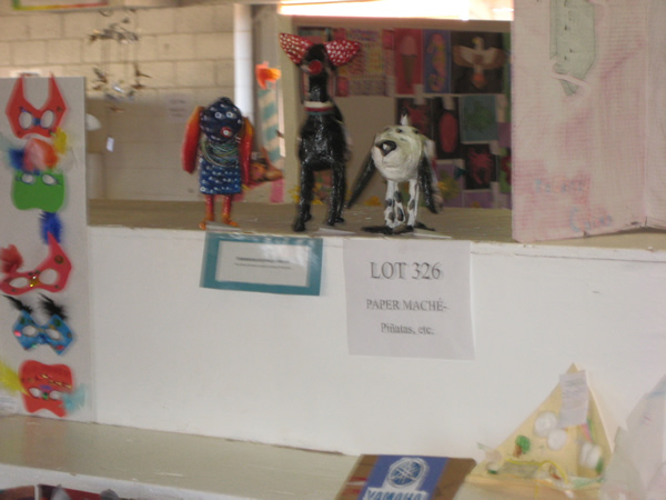 Display with paper mache and pinatas.