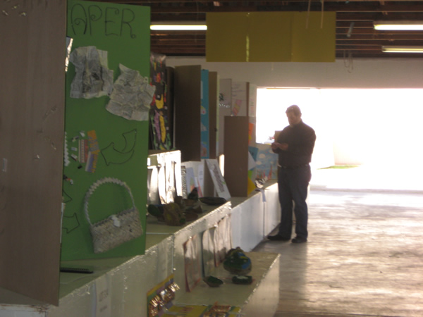 A judge thoroughly inspects some art.