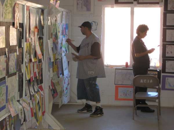 Judges take a closer look at the student art.
