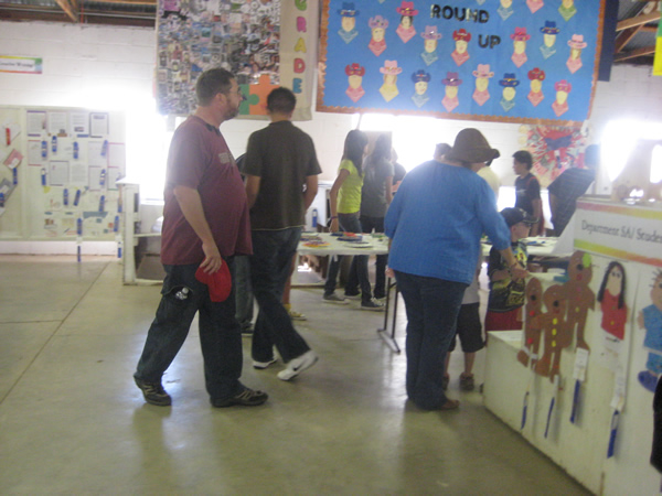 Attendees walk around all of the art exhibits.