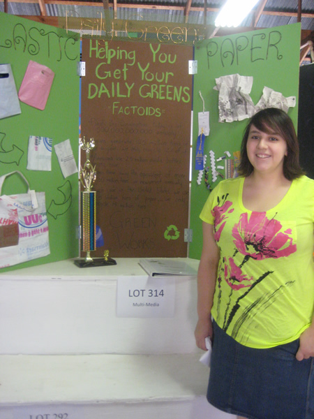 Student stands in front of a display
