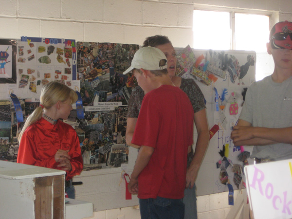 A student explains the contents of a poster.