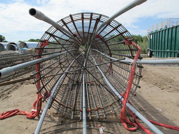 Re-Bar cage for to be installed in drill shaft- 75 ft long, approximately 7 ft diameter.